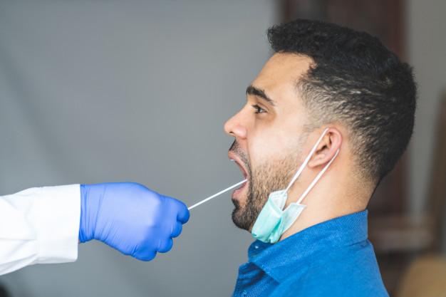 doing-coronavirus-test-young-man-from-saliva_102573-507